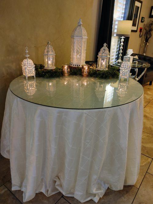 Rustic white lanterns with greenery theme